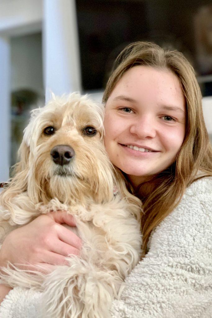Screen-free fun: Gracie Dix with dog